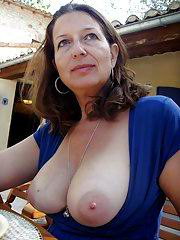Red haired mature shows her big tits